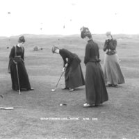 Golf on St Andrews links putting C07702.jpg